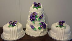 Purple and silver wedding cake with side cakes