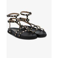 Valentino Valentino Garavani Rockstud gladiator sandals (€705) ❤ liked on Polyvore featuring shoes, sandals, black, black studded flats, black leather flats, gladiator sandal, black leather sandals and black gladiator sandals