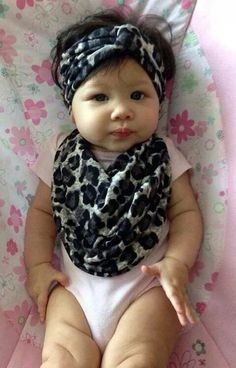 Love the headscarf on baby