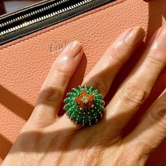 Emerald and carnelian ring from the new Cactus de Cartier collection. http://www.thejewelleryeditor.com/shop/product/cactus-de-cartier-emerald-carnelian-ring/ #jewelry