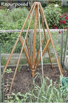 Take the fabric off an old outdoor table umbrella to transform it into a garden trellis. Wouldn't this look pretty as a trellis for a colorful clematis vine?