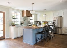 The kitchen was a space that perfectly aligned with our style of colonial cottage. Marble countertops and matching backsplash is broken up by a sudden change to classic subway tile. The white and gray is broken up by a custom wood vent hood.