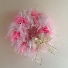 Pool noodle plus old feather boa equals cute wreath decoration for four-year old's birthday party!