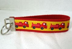 Fire Trucks Key Fob Key Chain Red Wristlet by CreativeJenV on Etsy (Accessories, Keychain, Wristlet, key fob, key chain, keychain, handmade, fabric key fob, fabric keychain, fire trucks, fire trucks key fob, fire trucks keychain, fire trucks wristlet, firetrucks key chain, black friday etsy)