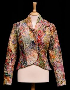 Maker:Childs, Winifred Amy Date:1946 - 1948 This intricately embroidered crazy patchwork jacket was made by Winifred Childs for her eldest daughter, who wore it to a tennis club dance on her first date with her future husband. The jacketfollows the previous make do and mend era, as the crazy patchwork is made from dressmaking fabric scraps, and the lining is recycled from another garment. It was originally worn with a white net dance dress with red spots.