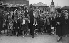 Children's Outing, August 7, 1936 A group of children with a policeman at West India Docks, London, before setting off on a day's outing paid for by the Port of London Authority Police.