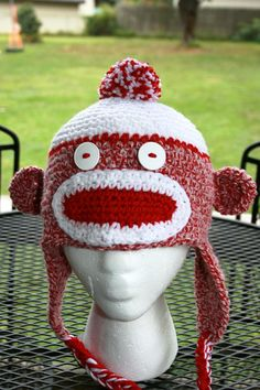 red and white sock monkey crochet hat