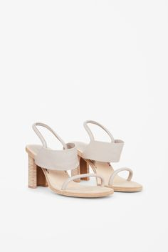 Designed with a folded high heel, these sandals have a neat rounded toe with a noubak sole. A slip-on style, they are secured with an elasticated leather strap on the back of the ankle.
