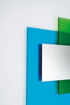 COLOUR ON COLOUR design Johanna Grawunder | Mirrors of different shapes and sizes with frames composed by slabs of transparent glass in different colours which by overlapping blend with one another to create new tonalities.