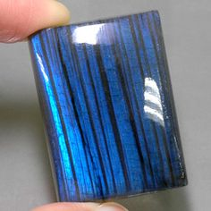 Labrodorite: GemSelect's Colored Gemstones -- Labradorite displays a schiller called labradorescence in lustrous metallic tints, often blue and green. It is mainly caused by interference of light from lattice distortion.