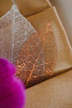 Metallic leaves from diy skeleton leaf idea I pinned also....wedding idea too!