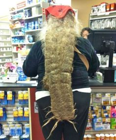WTF is it? Matted hair? A growth, A alien centipede? Better pickup some shit to get it off my neck at Walmart.