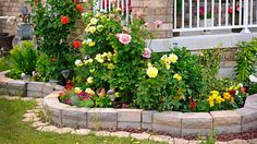 To add drama to your lawn, create a raised flower bed with a retaining wall. If you're wondering how to build a retaining wall, we have you covered.