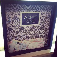 Shadow box + 12x12 scrapbook paper + lettering = ticket stub holder. Easy to make!