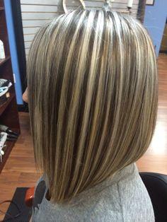 Cool h/l w asymmetrical long bob by Bravo salon and color studio
