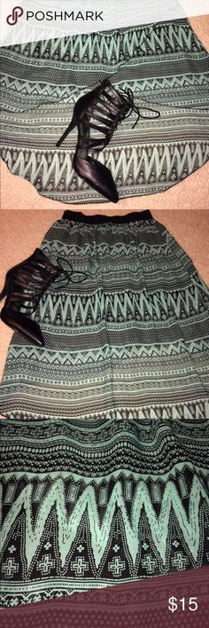 Charlotte Russe High Low Skirt Very Cote and lightweight. Mint green and black pattern. Fabrics criss crosses in the front. Black elastic waistband. Charlotte Russe Skirts High Low