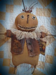 Prim pumpkin doll