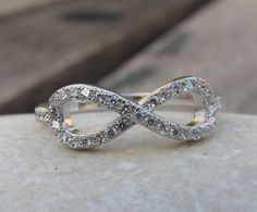 Crystal Infinity Ring. I want this to be my promise ring.