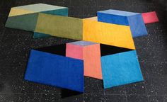 The 'Ninety Fourteen' collection of rugs by Daniil Tanygin is based on geometric patterns whose lines always follow either a 90- or a 14-degree angle, creating an optical illusion that the designer calls 'pseudo three-dimensionality'.
