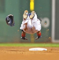 Happy 40th birthday Manny Ramirez. In this 2007 photo, the Red Sox outfielder dives safely into second base during a game against the Yankees. (Damian Strohmeyer/SI)