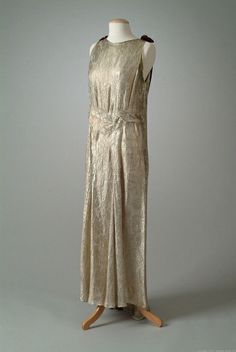 Gold brocade tissue evening gown accented with burgundy velvet pendants. (01_15_34) Meadow Brook Hall Historic Costume Collection 1934 front