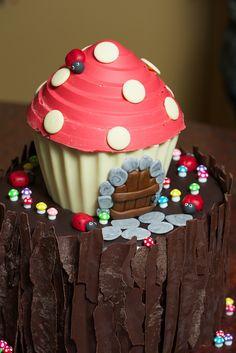 Fairy toadstool piñata cake on mud cake log birthday cake