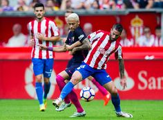 Neymar of FC Barcelona duels for the ball with Manuel Castellano 'Lillo' of Real Sporting de Gijon during the La Liga match between Real Sporting de...