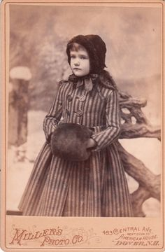Girl dressed for winter in Dover, NH.  Possible Photographer William E. Miller, late 1800s