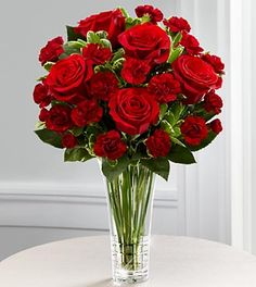 Sure, this is a valentines day flower arrangement... but I like the look of the big blooms with the little ones. Maybe with miniature roses?