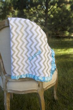 """These beautiful minky baby blankets are made for little ones to cuddle with! Now available with our great embroidery option. Name will be embroidered with coordinating thread, in the corner of the blanket, on the printed side.These are the perfect receiving blankets for newborns, or comfortable cuddle blanket for babies and toddlers.Measurements for these blankets is approximately 32""""x32"""". The top side of the blanket is a very soft printed cotton fabric, while the underside is ma..."""