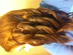 waterfall bangs through curled hair.