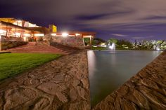 Dramatic Nighttime Photographs of Frank Lloyd Wright's Desert Laboratory: Andrew Pielage's photography shares the surreal beauty of Taliesin West's striking structures against a dark desert backdrop.