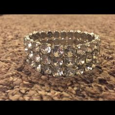 Bling bracelet Bling bracelet. In good condition!! It's silver with diamond bling. It would look adorable paired with dressy clothes. One size. Jewelry Bracelets