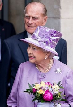 Queen Elizabeth II and Prince Philip, Duke of Edinburgh leave after attending Evensong in celebration of the centenary of the Order of the Companions of Honour at Hampton Court Palace on June 13, 2017 in London, England.