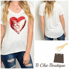 Heart Sequin Ivroy Tee Super cute and super soft! Ivory tee with a red sequin heart. Can be paired with absolutely anything! Made of rayon/ spandex blend. Bchic Tops Tees - Short Sleeve