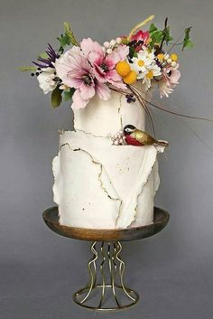 amazing wedding cakes small rustic wedding cakes white with ruffles decorated with flowers and a bird cake trends via Beautiful Wedding Cakes, Gorgeous Cakes, Pretty Cakes, Amazing Cakes, Naked Wedding Cake, Wedding Cake Rustic, White Wedding Cakes, Bird Cakes, Flower Cakes