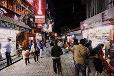 Top Seven Places For Shopping In Dharamshala-#tourtravelworld #shopping #dharamshala #dharamshala2021 #topmarkets #shoppingsprees #hillstation #himachalpradesh #dharamsala #shoppingindharamshala #mcleodganj #himachalculture #tourist #buddhist #tibetan #dharamshalaholidaypackage #holidays #trip #kotwalibazaar #semshooktibetanhandicrafts #divinebuddhahandicrafts #namgyalbookshop #greenshop #villageboutique #jogibararoadbazaar #antiqueitems #woolengarments #handicrafts #shoppingplaces… Shopping Places, Hill Station, Tourist Spots, Adventure Tours, Shopping Spree, Street View, Marketing, World, Top