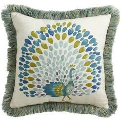 The pride and joy of our Calliope Collection, this peacock pillow highlights all the fresh colors featured in the collection. Trimmed in smoke blue fringe, it easily coordinates with our solid Calliope pillows. And, with fabric that's UV-protected and weather-resistant, it makes a stylish statement on indoor or outdoor seating.