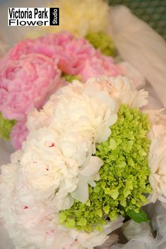 Bridal Bouquet arranged with Blush Peonies and White and Green Hydrangea featuring Bridesmaids Bouquets designed with Pink Peonies and Green Hydrangea