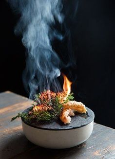 Jomfruhummer—a smoking plate of Norwegian lobster, parsley, juniper, and beetroot