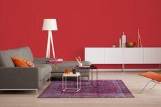 Trendfarbe Rot: Wände in rot beleben und machen das Wohnzimmer zu einem echten Hingucker.
