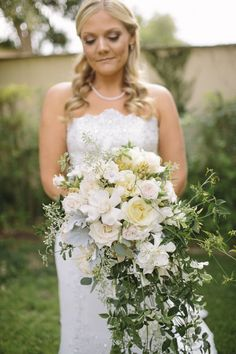 A nice return of the trail bouquet too!    Floral Design: Kristie VanHorn  Wedding Photography: Danielle Capito Photography