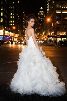 Ivory organza bridal ball gown, dropped waist sweetheart corset bodice with crystal Chantilly lace detail, ruffled skirt with lace appliques throughout and chapel train Bridal Gowns from Lovelle By Lazaro - Bridal Style LL4502 by JLM Couture, Inc.