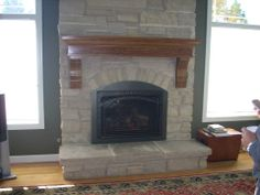 Arched fireplace gets a facelift with custom arched insert.