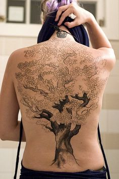 Tree tat - I like the trunk on this one, not the size or flower leaf things
