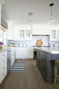 Classic White Kitchen   Hood Design with Cabinet Doors for storage   Tongue & Groove cladded Ceiling