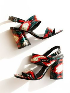 """Slingback with 4"""" cylindrical heel. Adjustable ankle strap with buckle closure. Color- Red/Green Snake Material- 100% water snake upper, 100% cow leather sole. Runs small, size up."""