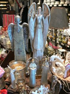 Find gifts like these angel figurines to fit any decor at Beyond the Door in II Creeks.