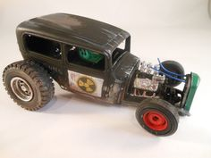 Ford RatRod 1/24 scale miniature model car in black and nuclear