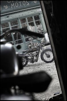 Vintage motorcycle. I like the way the picture is tilted and from so far away